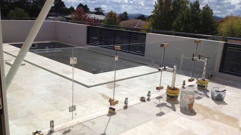 Tidying up after installation of frameless glass pool fencing