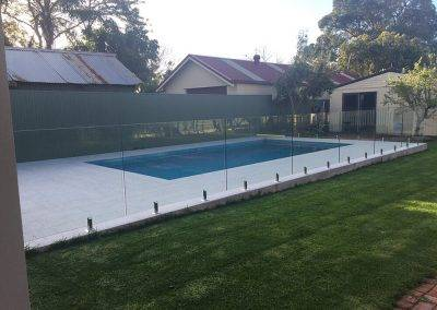 This Riverland home got a bit of GFI magic with transparent, frameless glass fence to adorn their swimming pool