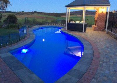 GFI designed and installed this architectural swimming pool glass fence in a home in Mount Gambier