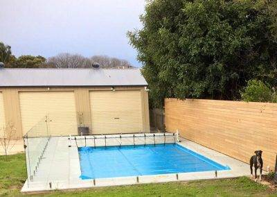 Installing a clear glass fence around this swimming pool in Mildura enabled the client's slatted wooden panel to be seen through