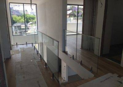 Frameless glass balustrades with stainless steel handrails