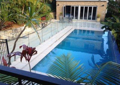 Installing a frameless glass pool fence for a client in Renmark using best quality, australian made, Boresi clamps and spigots