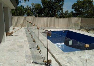 Swimming pool glass fence installation in progress at this newly constructed home in Loxton