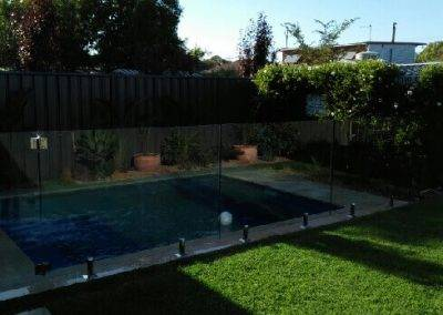 Our glass fence provides safety around this swimming pool and adds an elegant charm to this client's backyard in Barmera