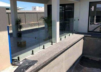 Glass balustrade working as swimming pool fencing Lightsview