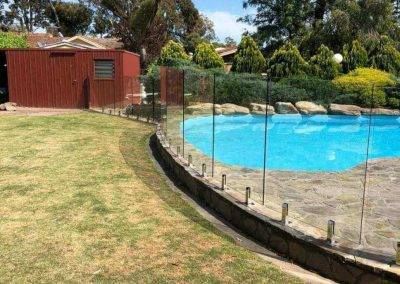 Glass fencing installed around swimming pool Flagstaff hill