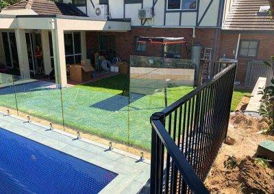 Glass fencing installed between children play area and pool Torrens park