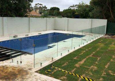 Glass swimming pool between the swimming pool garden and house in Adelaide