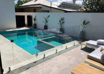 Glass swimming pool fencing in a very modern setting Westbourne Park